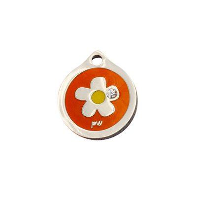 Placa identificativa con una flor y un diamante sobre fondo naranja