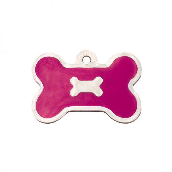 Placa de identificación para perros con forma de hueso y un hueso sobre fondo fucsia.