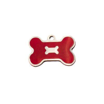 Placa identificativa con forma de hueso y un hueso sobre fondo rojo.
